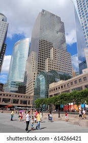 NEW YORK, USA - JULY 4, 2013: People walk by 200 Vesey Street, formerly known as Three World Financial Center in New York City. It is the world headquarters of American Express.