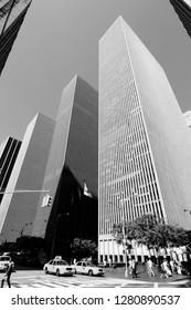 NEW YORK, USA - JULY 5, 2013: People walk along 6th Avenue in New York. Almost 19 million people live in New York City metropolitan area.