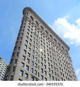 NEW YORK, USA - JULY 5, 2013: Flatiron Building in New York. Flatiron is one of the most recognizable buildings in NY and is considered National Historic Landmark.