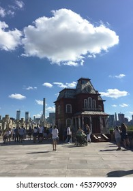 NEW YORK, USA - July 5, 2016: The Roof Garden of the Metropolitan Museum of Art. A large-scale sculpture by acclaimed British artist Cornelia Parker, inspired by the paintings of Edward Hopper.