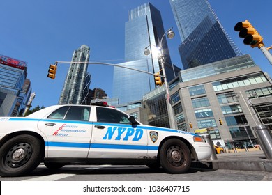 NEW YORK, USA - JULY 6, 2013: NYPD police car at Columbus Circle in New York. NYPD employs 34,500 uniformed officers.