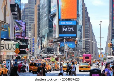 NEW YORK, USA - JULY 7, 2013: People visit Times Square in New York. The square at junction of Broadway and 7th Avenue has some 39 million visitors anually.