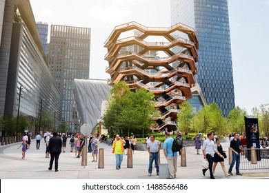 New York, USA - July 9, 2019: Vessel (architect Thomas Heatherwick), Hudson Yards Staircase, at the Hudson Yards district in Manhattan on sunny summer day. Focus on Vessel.