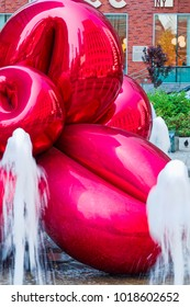 New York, USA - June 08, 2015: Red Balloon Flower by Jeff Koons at 7 World Trade Center on November 10, 2013. It is one of Koons' signature highly polished, public stainless steel sculptures
