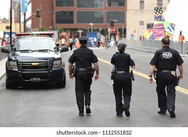 NEW YORK, USA - June 10, 2018: The New York City Police Department (NYPD) police officers performing his duties on the streets of Manhattan.