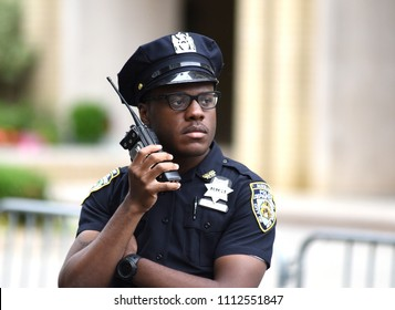 NEW YORK, USA - June 10, 2018: The New York City Police Department (NYPD) police officer performing his duties on the streets of Manhattan.