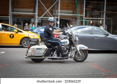 NEW YORK, USA - JUNE 14, 2014: NYPD officers on motorcycles providing security in Manhattan on June 14, 2014. New York Police Department, established in 1845, is the largest police force in USA
