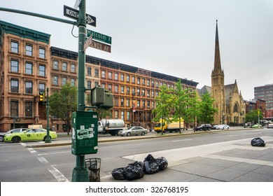 NEW YORK, USA - JUNE 16, 2015: Malcolm X Boulevard in Harlem district. Harlem is a large neighborhood of the New York City, known as a major African American residential center.
