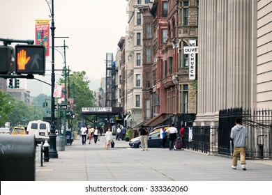 NEW YORK, USA - JUNE 16, 2015: Malcolm X Boulevard in Harlem district. Harlem is a large neighborhood within the northern section of New York City, known as a major African American residential center