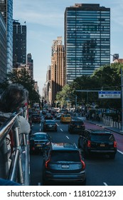 New York, USA - June 2, 2018: View of First Avenue, New York, USA, from the top of tourist bus. First Avenue is a north-south thoroughfare and a major road on the East Side of Manhattan.
