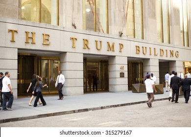 New York, New York, USA - June 2, 2011: People walking by The Trump Building at 40 Wall Street in the financial district of lower Manhattan.