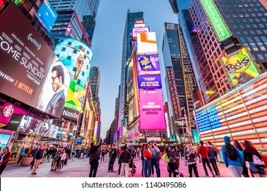 NEW YORK, USA - JUNE 20, 2018: The contemporary architecture of New York city in the USA at Times Square showcasing its neon lights, tons of tourists, and famous stores at night.