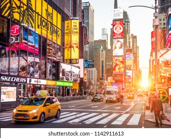 NEW YORK, USA - JUNE 20, 2018: The contemporary architecture of Times Square in New York city, USA at night with its stores, neon lights, and tons of tourists shopping and enjoying themselves.