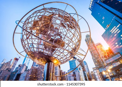 NEW YORK, USA - JUNE 20, 2018: The contemporary architecture of New York city at night showcasing the Columbus Circle with its iconic Globe sculpture surrounded by skyscrapers.
