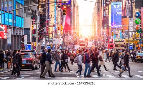 NEW YORK, USA - JUNE 20, 2018: The contemporary architecture of Times Square in New York city, USA at night showcasing its stores, neon lights and tons of tourists enjoying themselves.