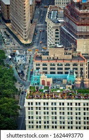 New York; USA; June 2014: Aerial view of street in New York City with the Flatiron building and roof top restaurant