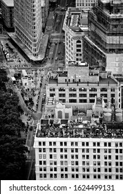 New York; USA; June 2014: Aerial view of street in New York City with the Flatiron building and roof top restaurant in black and white