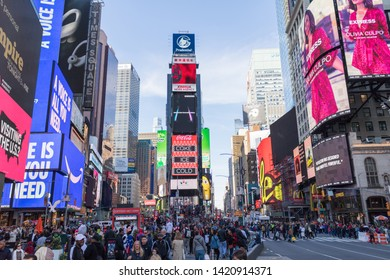 New York, USA - June 2019 - People walking down seventh avenue at Times Square at day, Manhattan.