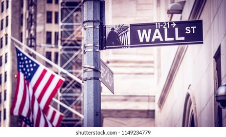 NEW YORK, USA - JUNE 22, 2018: The architecture of Wall Street in Lower Manhattan, New York, USA with its skyscrapers and monument.