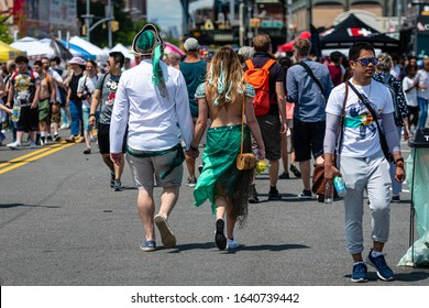 New York, USA - June 22, 2019: People participate in the Coney Islands annual mermaid parade, Brooklyn