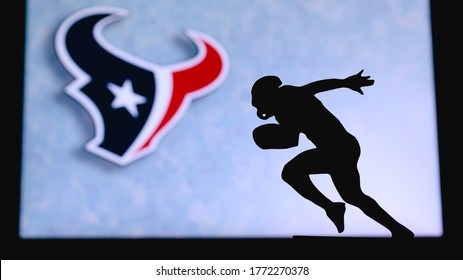 NEW YORK, USA, JUNE 23. 2020: Houston Texans. Silhouette of professional american football player. Logo of NFL club in background, edit space.