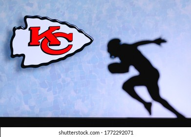 NEW YORK, USA, JUNE 23. 2020:   Kansas City Chiefs. Silhouette of professional american football player. Logo of NFL club in background, edit space.