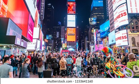 NEW YORK, USA - JUNE 25, 2018: The architecture of Times Square in New York city, USA with lots of tourists, neon lights, outdoors, and countless stores.