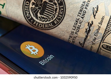 New york, USA - June 26, 2017: Bitcoin against dollar system. Bitcoin smartphone application close-up against federal reserve system.