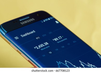 New york, USA - June 27, 2017: BTC market exchange on smartphone app coinbase. Growing graphic of bitcoin currency