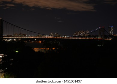 NEW YORK, USA - JUNE 30, 2019: Night view to George Washington Bridge from Fort Tryon Park