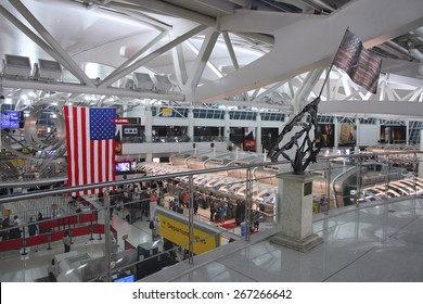 NEW YORK, USA - JUNE 7, 2013: People hurry at JFK Airport in New York. In 2012, the airport handled 49.3 million passengers (6th busiest in the United States).