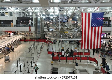 NEW YORK, USA - JUNE 7, 2013: People hurry at JFK Airport on June 7, 2013 in New York. In 2012, the airport handled 49.3 million passengers (6th busiest in the United States).