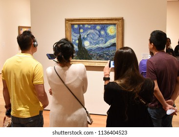 New York, USA - June 8, 2018: People near the Starry Night by Vincent van Gogh painting in Museum of Modern Art in New York City.