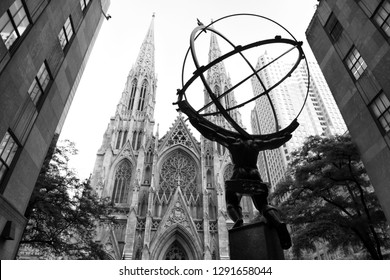 New York, USA - June 8, 2018: The statue of Atlas in Rockefeller Center stands across from St Patrick's Cathedral.
