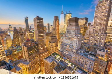 New York, New York, USA Lower Manhattan Financial District cityscape from above at twilight.