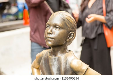 New York/ New York/ USA - Mai 30 2018: Front the statue of fearless girl facing the famous bull sculpture of Wall Street, the World's Biggest Dream Success.