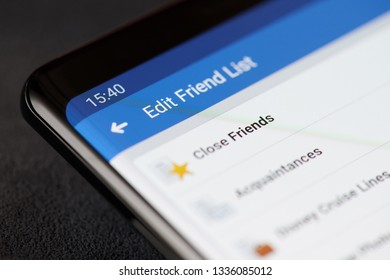 New york, USA - march 11, 2019: Close friends in facebook account on smartphone screen close up view