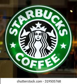 New York, New York, USA - March 14, 2011: Illuminated Starbucks sign in a Starbucks restaurant on 34th street.
