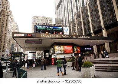 New York, New York, USA - March 14, 2011: People walking by the entrance to Madison Square Garden and Penn Station on Seventh Avenue in Manhattan in the afternoon.
