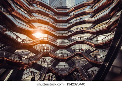 New York, USA -  MARCH 18, 2019: Modern architecture building Vessel spiral staircase is the centerpiece of the Hudson Yards in New York City