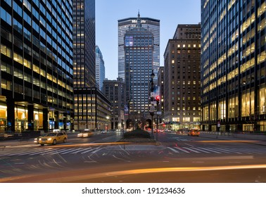 NEW YORK, USA - MARCH 18: Symmetrical composition of the illuminated Metlife building at night on Fifth Park Avenue with many light trails of cars and yellow cabs, on March 18, 2014 in New York, USA.