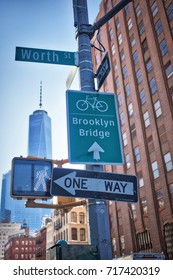 NEW YORK, USA - MARCH 2017 -  Brooklyn bridge and Worth sign at Tribeca.