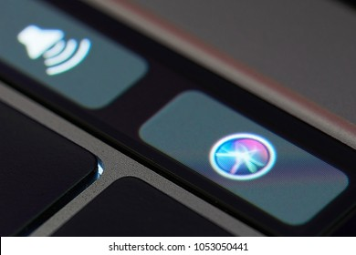 New york, USA - March 23, 2018: Siri assistant icon on touch bar of macbook latop close up