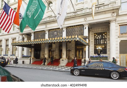 New York, New York, USA -  March 23, 2016: The main entrance of the Plaza Hotel. People can be seen walking by as well as entering and leaving via the red carpeted staircase.