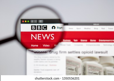 New York, USA - March 26, 2019: BBC News website homepage. BBC logo visible  through a magnifying glass.