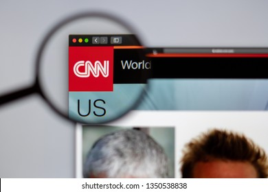New York, USA - March 26, 2019: CNN website homepage. CNN channel logo visible  through a magnifying glass.
