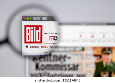 New York, USA - March 26, 2019: Germany news media Bild website homepage. Bild logo visible  through a magnifying glass.