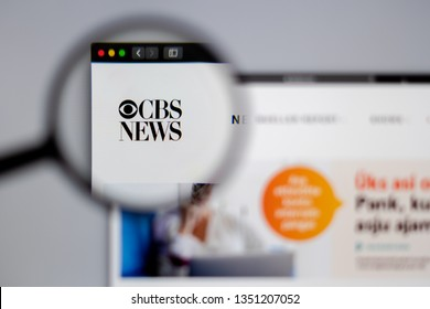 New York, USA - March 26, 2019: News media CBS News website homepage. CBS logo visible  through a magnifying glass.