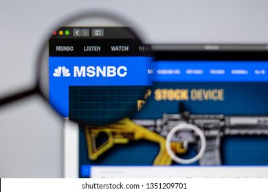 New York, USA - March 26, 2019: News media MSNBC website homepage. MSNBC News logo visible  through a magnifying glass.