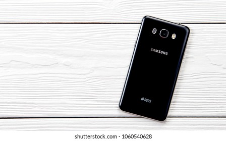 New York, USA - March 27, 2018: Samsung galaxy duos smartphone back side on wooden background.